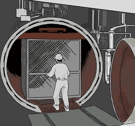 大きな釜で缶詰を加熱殺菌!